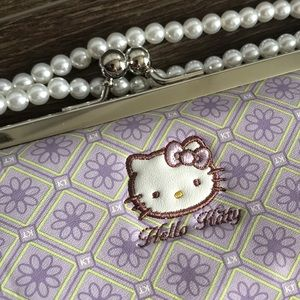 Loungefly Bags - Hello kitty Sanrio lavender and yellow clutch.